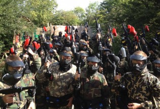 Group of paintballers kitted up at Grendon Lakes at Conflict Paintball