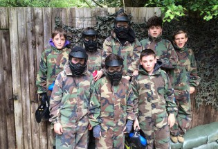 Group of children kitted up ready for Low Impact Paintball at Grendon Lakes